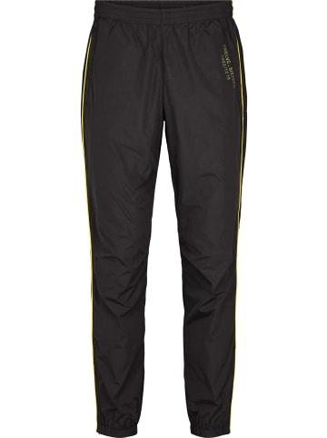 Twelvesixteen 12.16 Training pants Track pants in black/yellow