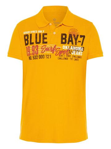 Oklahoma Jeans Poloshirt in 14-1064 Saffron
