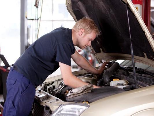 Mechanics Look/ Over 20 Year Auto Engine Repair