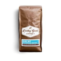 Bag of whole bean Decaf Mountain Water coffee, roasted by Lucky Goat Coffee Co.