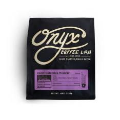 Bag of whole bean Decaf Colombia Medellín coffee, roasted by Onyx Coffee Lab