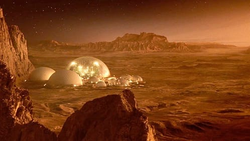 Image of a 3 domed surface outpost on Mars as seen from cliffs above looking out over plains.