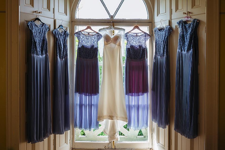 Wedding dresses hanging on the windows