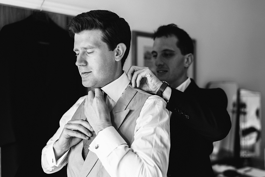 Groom fixing his tie
