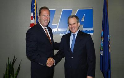 Attorney-General-Schneiderman-with-Law.jpg