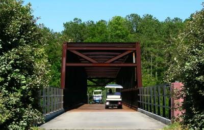 golf_carts_on_hwy_74_bridge-w1200.jpg