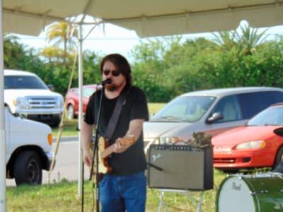 Damon_Fowler_performing-PIGS.jpg