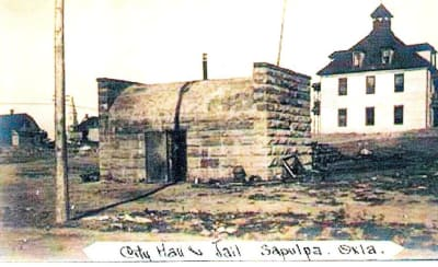 1904-Sapulpa-Jail.-Building-in-background-is-Dewey-College.-Creek-County-Courthouse-now-stands.jpg