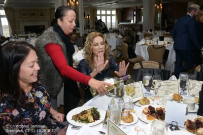 050_Copyright-Christopher-Semmes-Greenwich_CT-11-16-2018-Kathie-Lee-at-table-telling-person-to-stop-pouring-wine.jpg