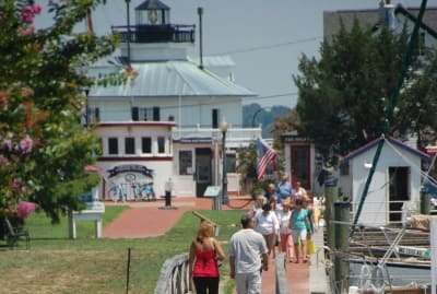 St_Michaels_people_walking_along_harbor_700_x_470.jpg