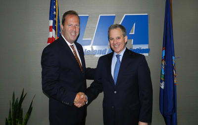 Attorney-General-Schneiderman-with-Law.jpg