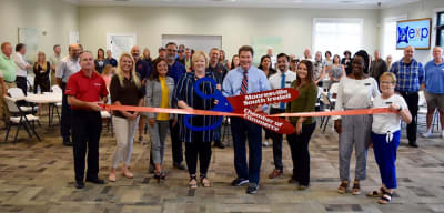 April-Villines-with-EXP-Realty-Ribbon-Cutting.jpg