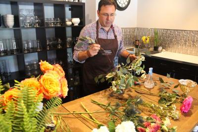 Andrew's_Garden_Arranging_Flowers.jpg