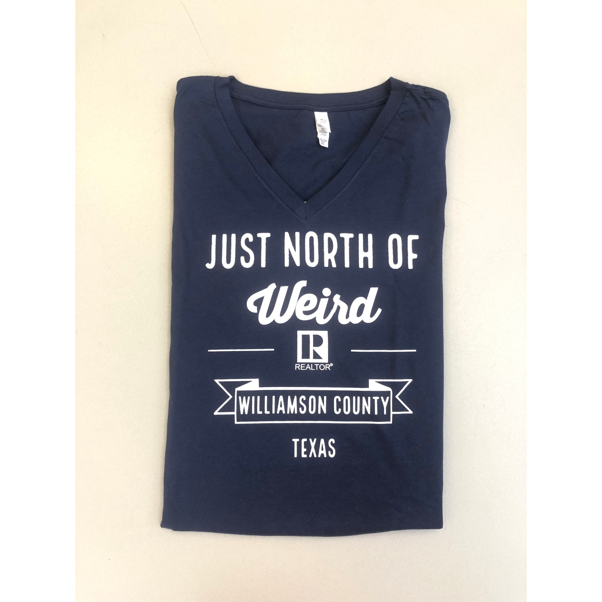 Just North Of Weird NAVY REALTOR® V-Neck provided by WCREALTORS