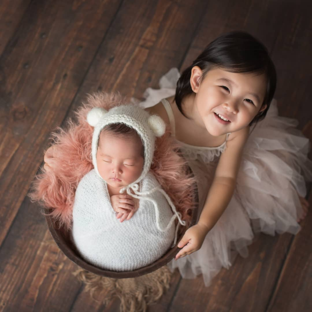 Newborn baby with her sister