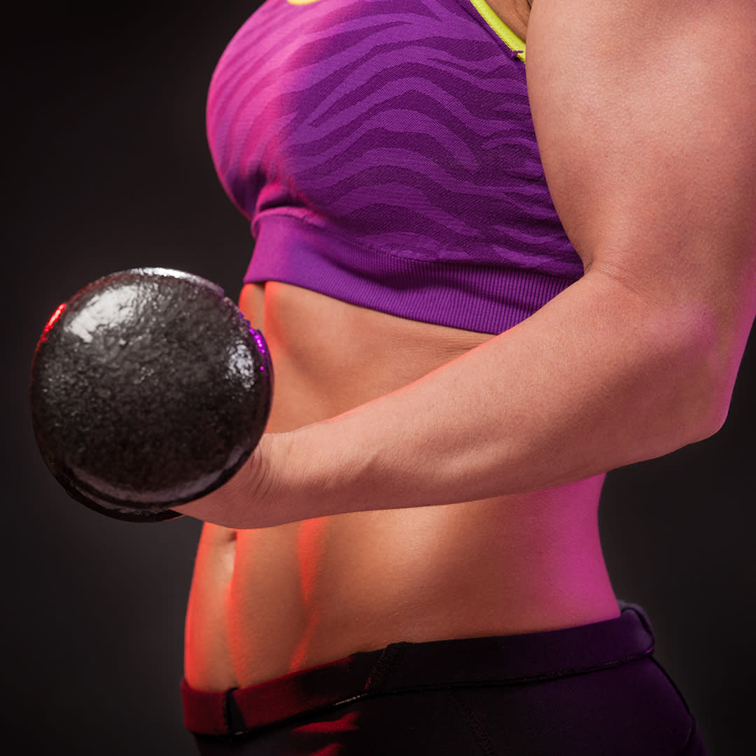 Photo of a woman flexing a bicep with a dumbbell in hand