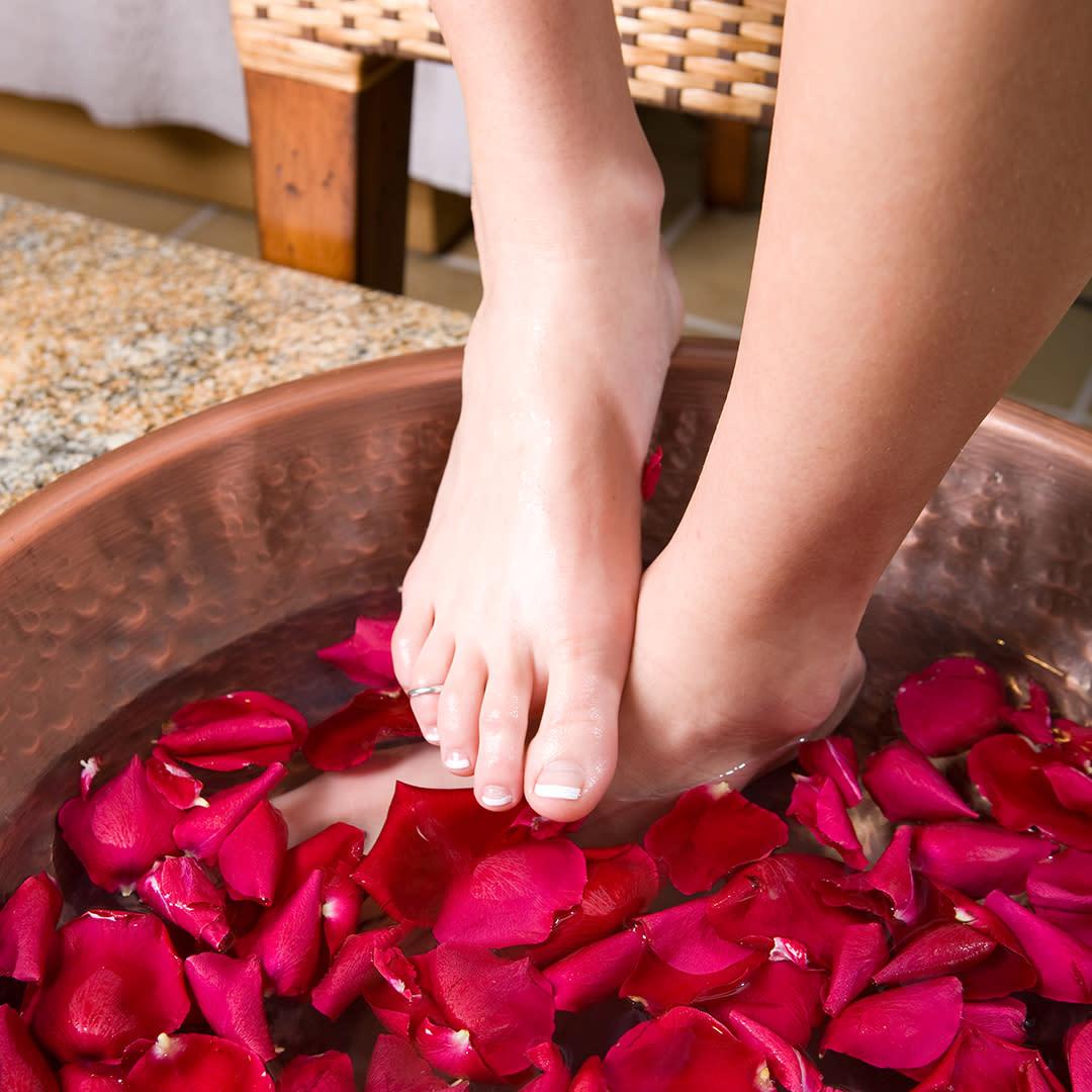 Woman's feet in spa basin