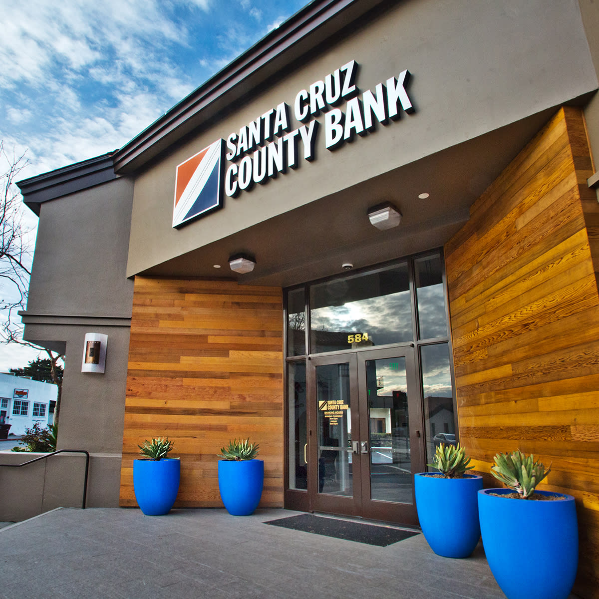 Photo of the front entrance of Santa Cruz County Bank's Monterey Branch on Munras Avenue