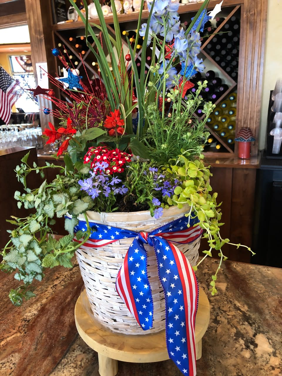 Photo of a 4th of July (or patriotic) floral arrangement