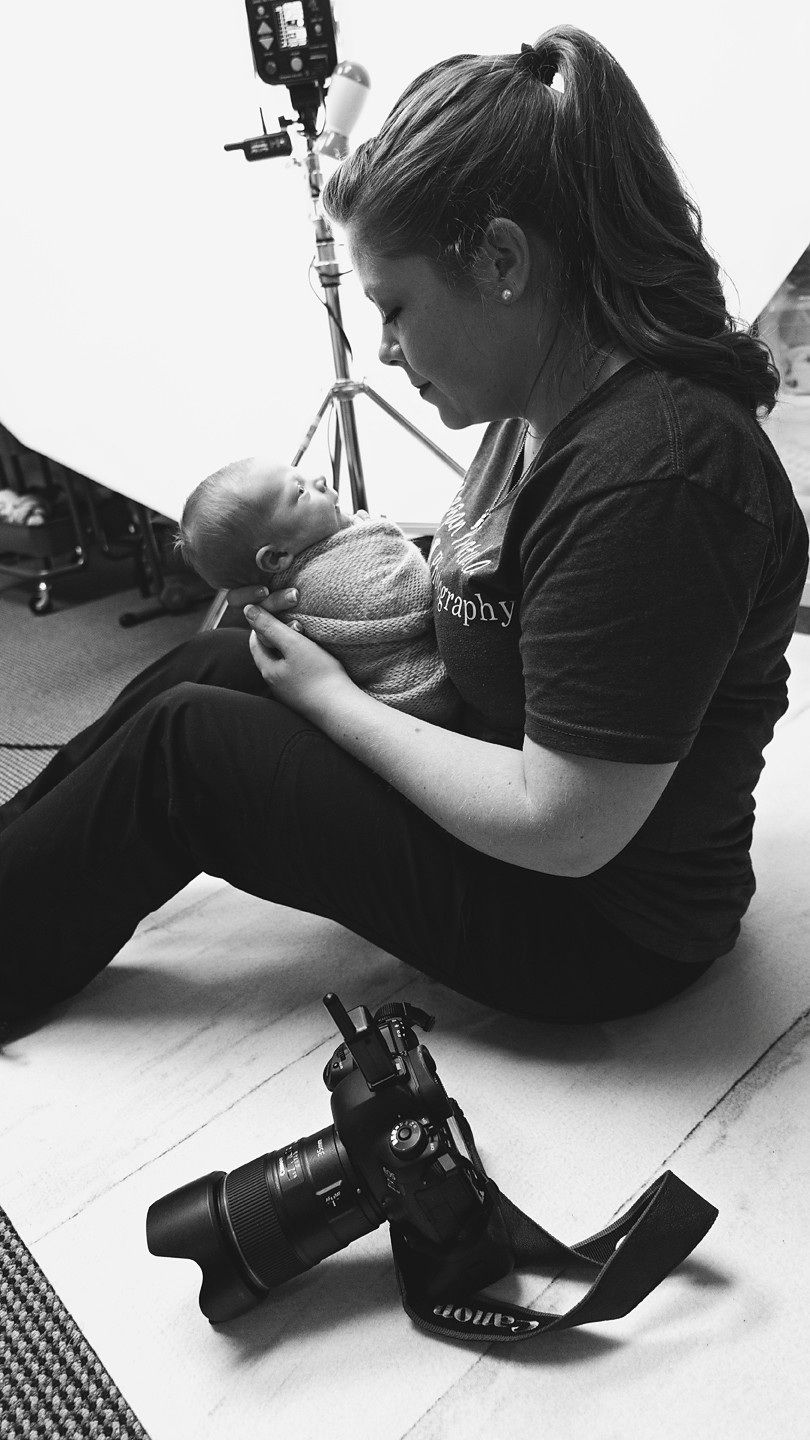 black and white photo of Megan with newborn