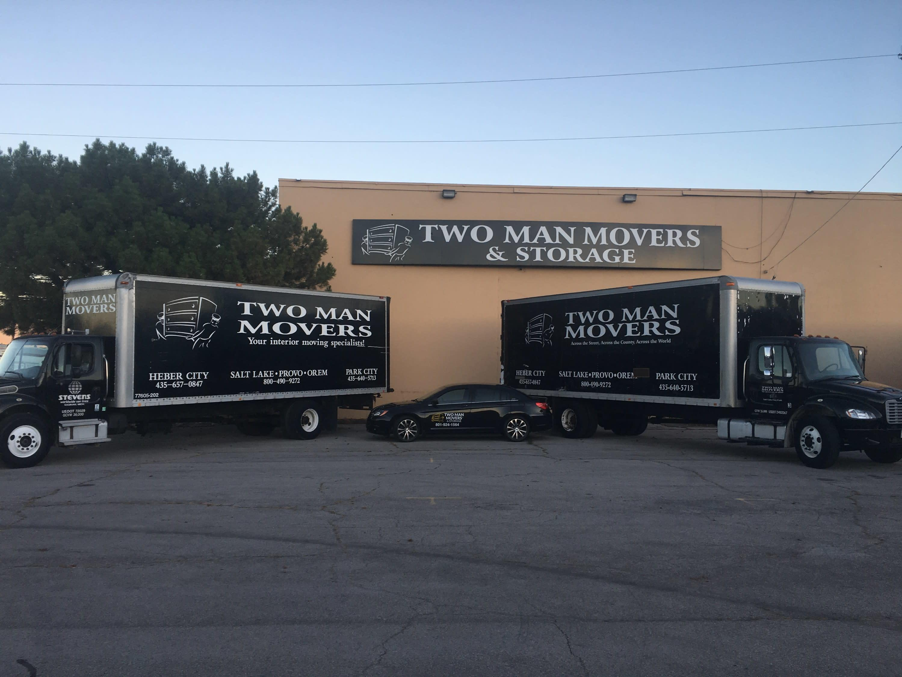 Two Man Movers Trucks and Sign