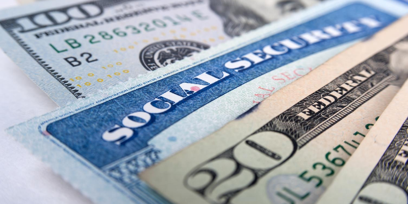 """Currency and a Social Security Card, Symbolizing """"Add Half a Million Bucks to Your Savings"""""""