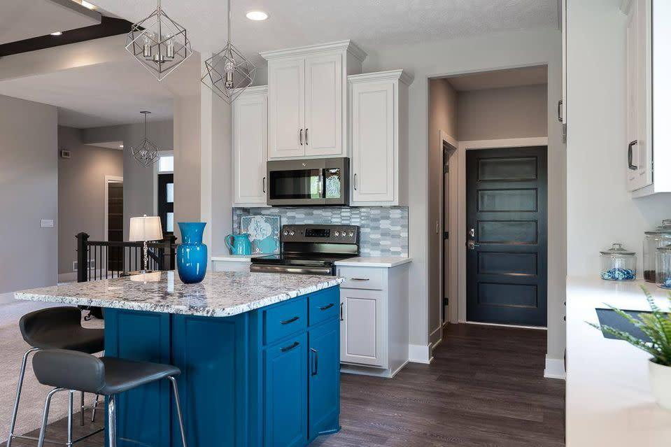 Bright open kitchen with a pop of blue
