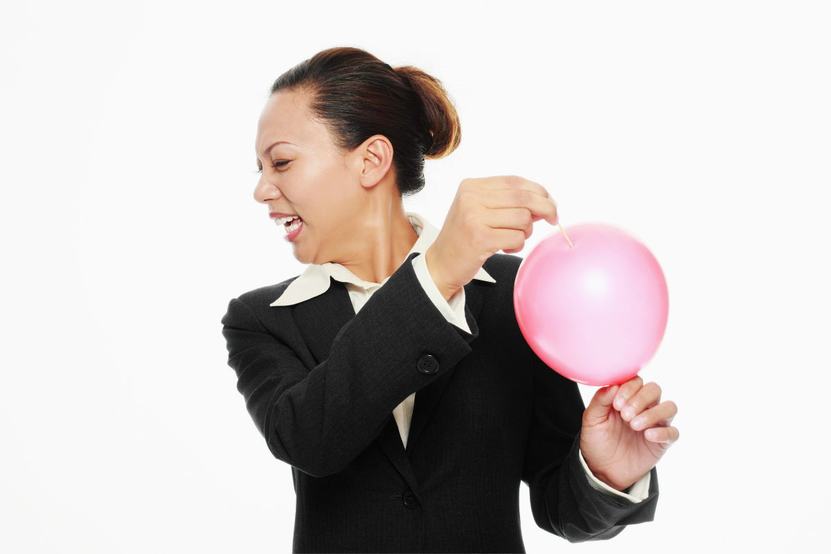 "Woman popping balloon with pin, symbolizing post, ""The Souffle & The Sledgehammer."""