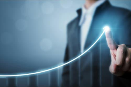 Business person manipulating virtual graph displaying growth