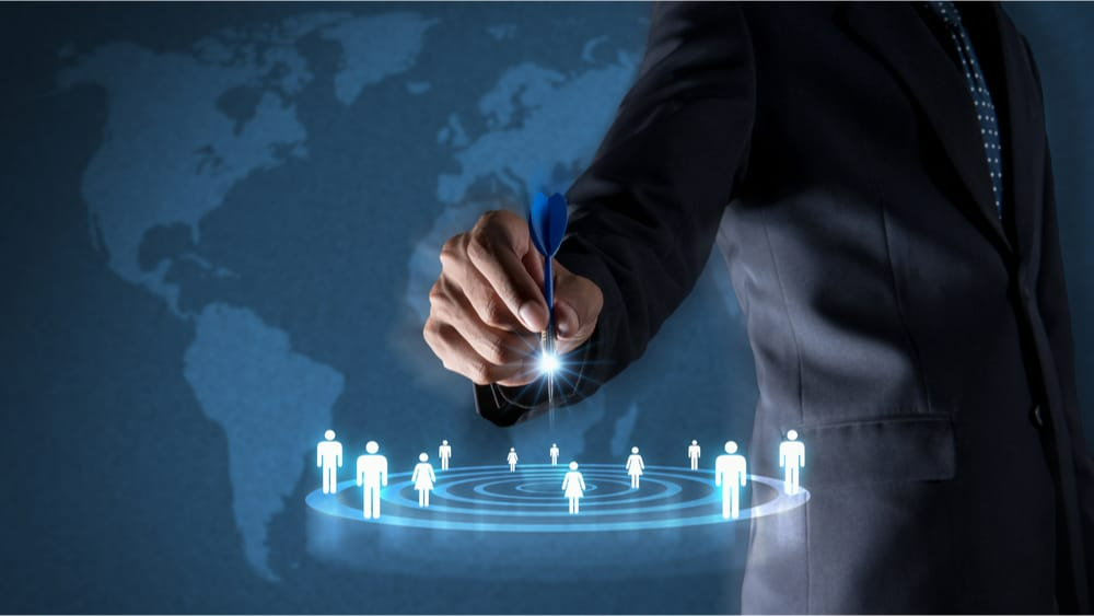 Business person displaying virtual representation of a target audience
