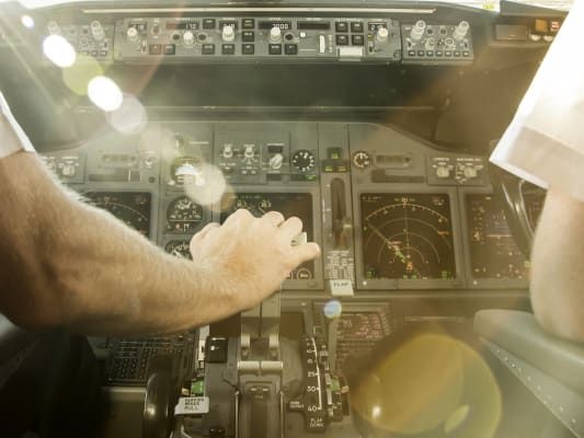 Pilots steering commercial airplane.