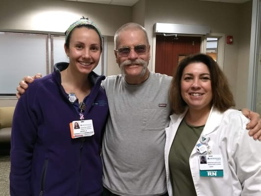 Jeffery with hospital employees Leah and Angela