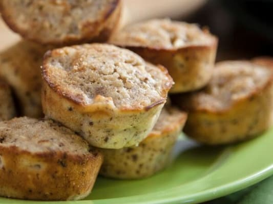 Apple cinnamon muffins on green plate.