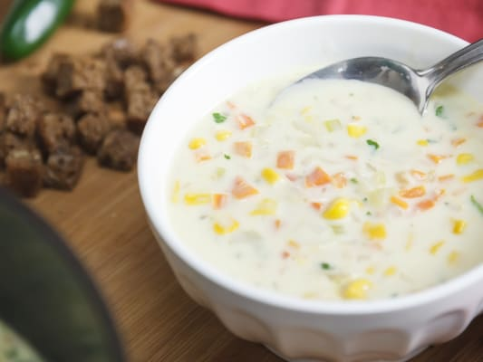 A bowl of fire roasted corn soup.