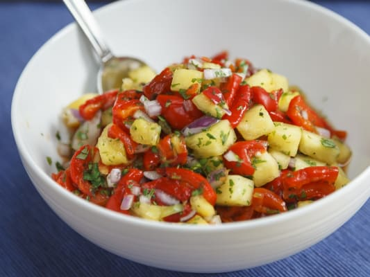 A small bowl of roasted red pepper and pineapple salsa ready to serve.
