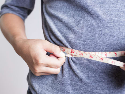 Measuring waist and weight loss
