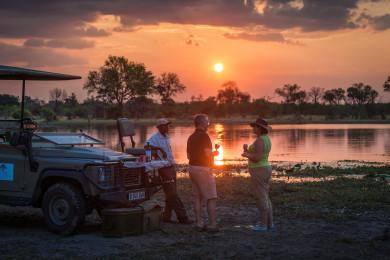 Sundowners on Safari at Machaba Camp
