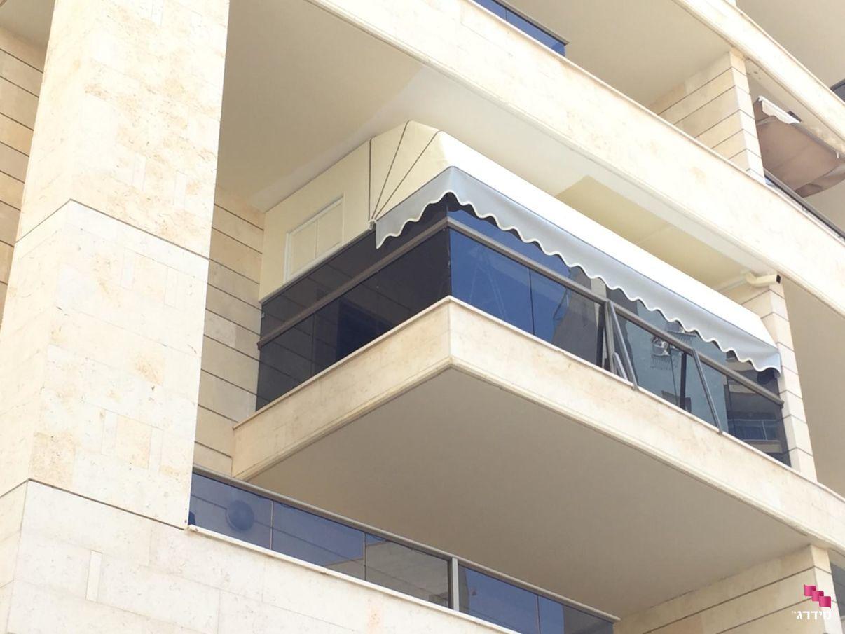 מרקיזה לבמרפסת של בניין | סוכך למרפסת
