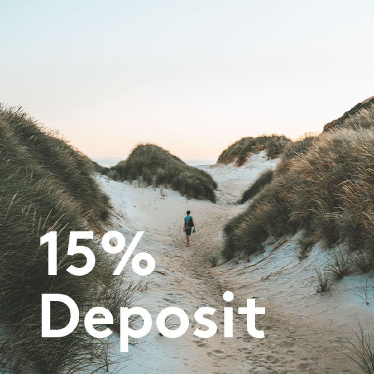 15% off text over man walking in sand dunes