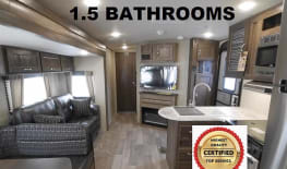 2018 Pure luxury trailer with 1.5 baths, double slide, and private bunk room! FREE Compact 4 seater Golf Cart rental with any booking of 6 nights or more! This unit is delivery only!