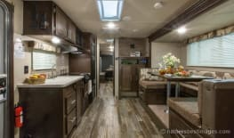 Mid Sized Camper Toy Hauler with large garage, slide-out, outside shower, queen bed, king bed (or 2 twins), dinette that sleeps, interior/exterior speakers and tv mounts.
