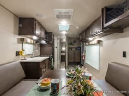 Mid Sized Camper Toy Hauler with large garage, outside shower, queen bed, king bed (or 2 twins), & dinette, interior/exterior speakers and tv mounts.