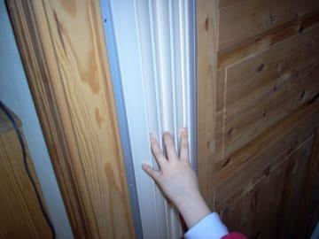 Fingerbeskytteren grå