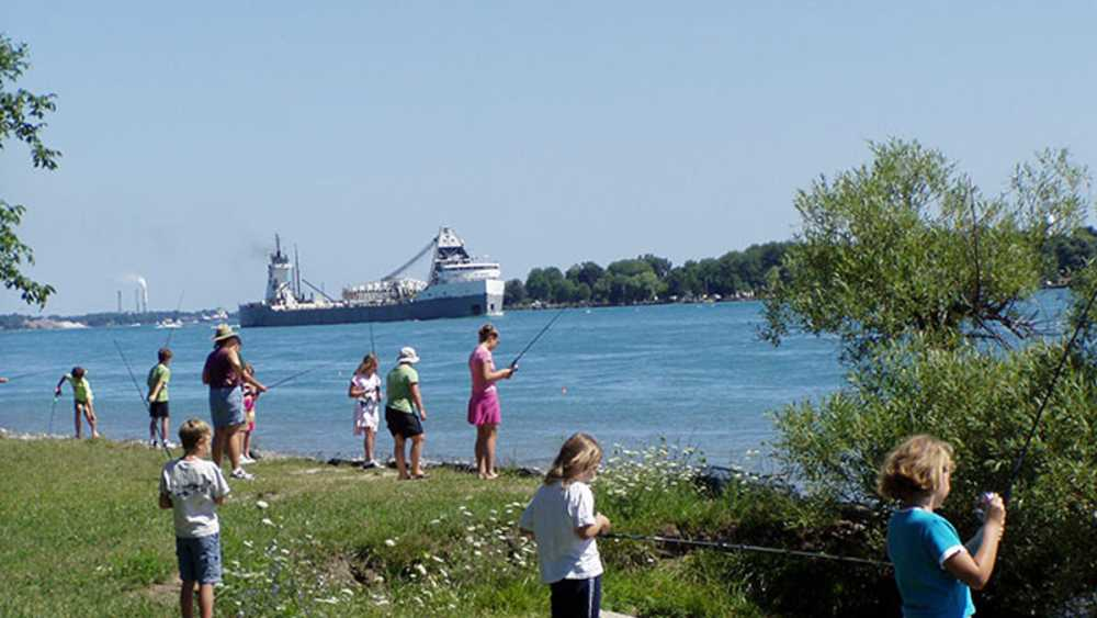 Kids and adults fishing in the St. Clair river