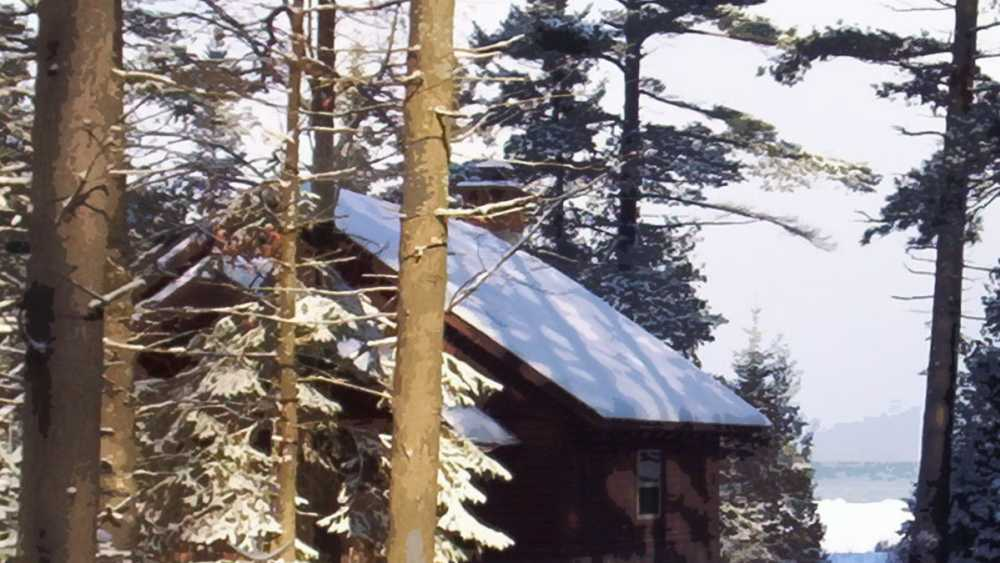 Snow covered cabin in the woods