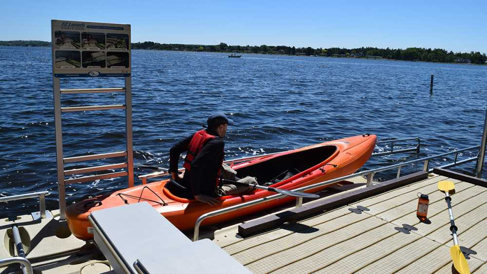 A kayaker uses an accessible launch at Mitchell State Park in Wexford County.
