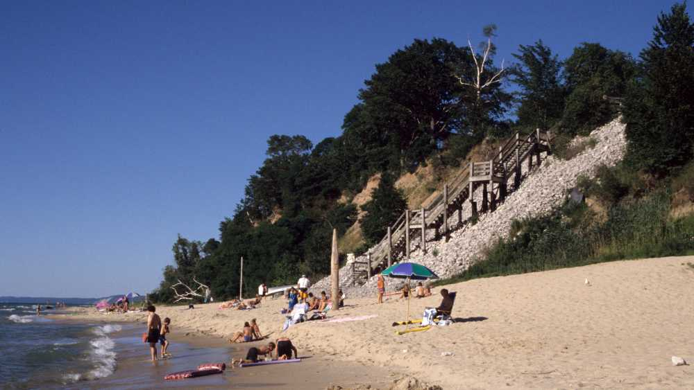 Beach goers on the sandy shore of Orchard Beach State Park