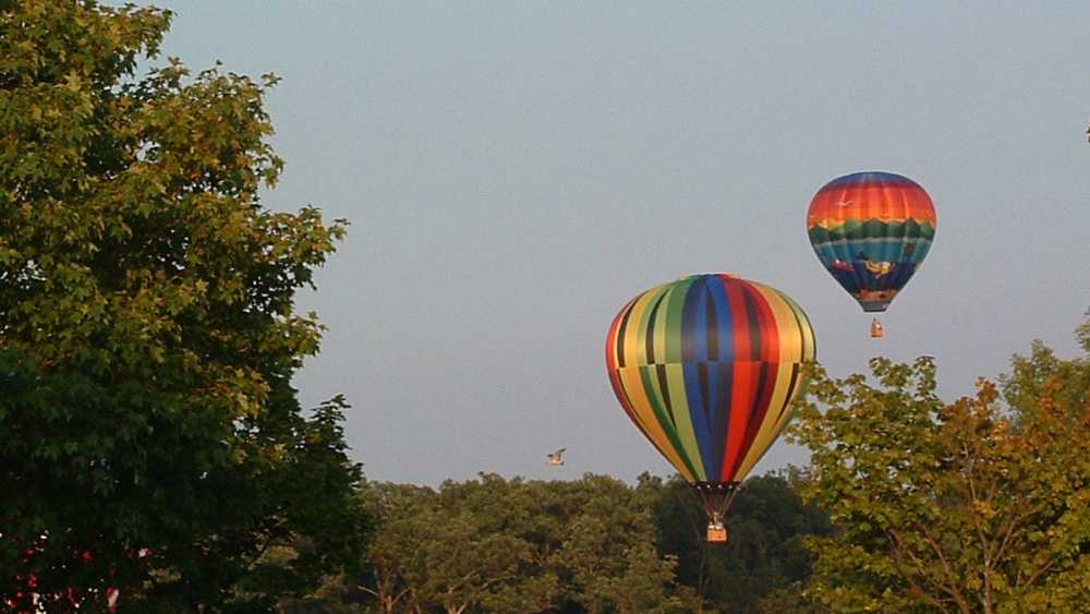 Hot air balloons fly over Seven Lakes State Park