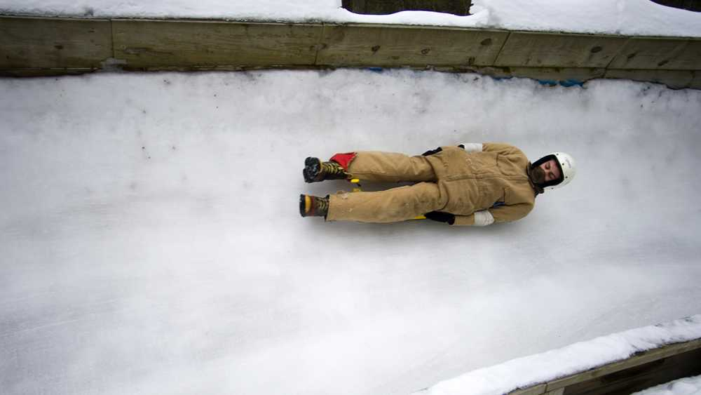 A person sledding  on the luge at the Winter Sports Complex.