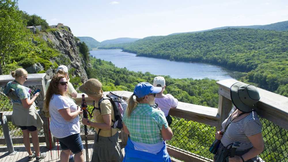 Park visitors at the Lake of the Clouds scenic overlook